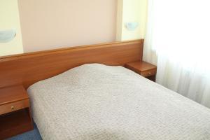 Кровать или кровати в номере Hotel КTC Ugra-Classik