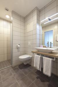 A bathroom at Le Relais D'arc Et Senans