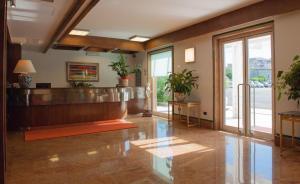 The lobby or reception area at Hotel La Pergola