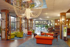 The lobby or reception area at Hotel Sopron