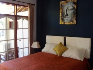 A bed or beds in a room at Les Rizieres Lombok
