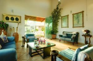 Uma área de estar em Pousada Novo Prado