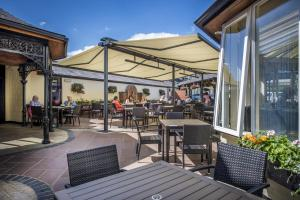 A restaurant or other place to eat at The Three Swans Hotel, Market Harborough, Leicestershire