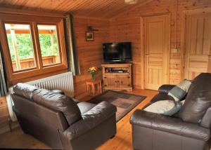 A seating area at Heronstone Lodges