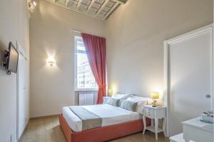 Un ou plusieurs lits dans un hébergement de l'établissement Little Queen Suite