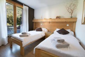 A bed or beds in a room at Chalet Beatrice
