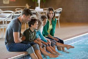 A family staying at AmericInn by Wyndham Roseau