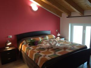 Un ou plusieurs lits dans un hébergement de l'établissement Residence Le Azalee & SPA