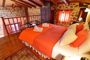 Ένα ή περισσότερα κρεβάτια σε δωμάτιο στο Filiantra Suites