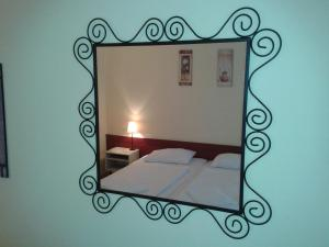 A bed or beds in a room at Bed Breakfast Hotel Budapest