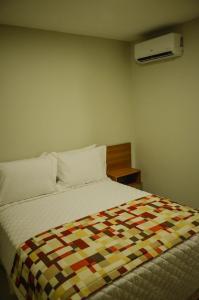 Кровать или кровати в номере Aquarena Hotel