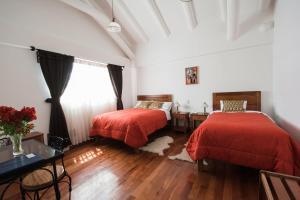 Кровать или кровати в номере Wilkamayu Hotel