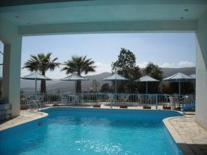 The swimming pool at or near Olive Branch Hotel