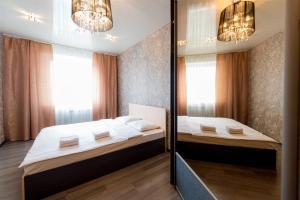 Кровать или кровати в номере Пять Звёзд Парк Пушкина