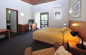 A bed or beds in a room at Groote Eylandt Lodge
