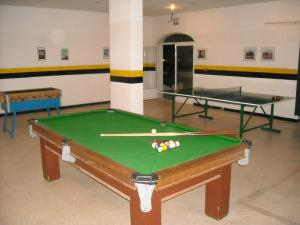 A pool table at Olive Branch Hotel
