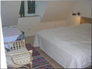En eller flere senge i et værelse på Klosterpensionen
