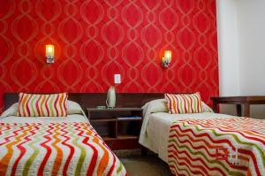 Letto o letti in una camera di Grand Hotel