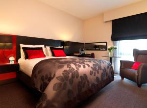 A bed or beds in a room at Guildford Harbour Hotel & Spa