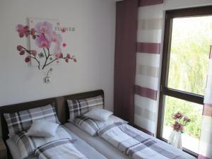 Ein Bett oder Betten in einem Zimmer der Unterkunft Ferienwohnung im Herzen von Peitz