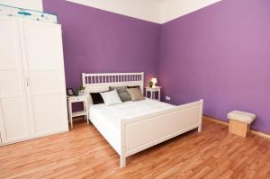 Ein Bett oder Betten in einem Zimmer der Unterkunft City Center Apartments