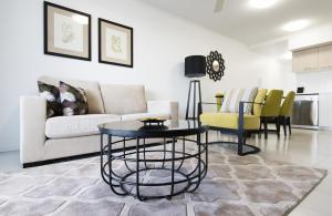 Ein Sitzbereich in der Unterkunft Riviera Mackay