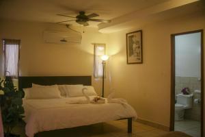 Cama o camas de una habitación en Hotel La Estación