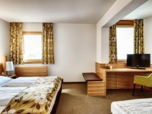 Ein Bett oder Betten in einem Zimmer der Unterkunft Alphotel Innsbruck