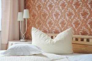 Ein Bett oder Betten in einem Zimmer der Unterkunft Rieslinghaus Bernkastel (ehm.Weinhaus Porn)