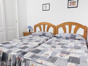 A bed or beds in a room at Apartamentos Topacio Unitursa