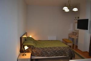 Кровать или кровати в номере Apartment Gut