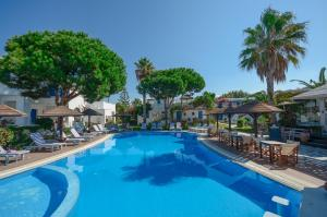 The swimming pool at or near Alkyoni Beach Hotel