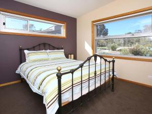 A bed or beds in a room at The Chocolate Lily Bed & Breakfast