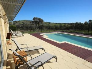 The swimming pool at or near The Chocolate Lily Bed & Breakfast