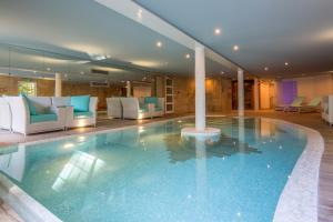 The swimming pool at or near Le Clos - Relais & Chateaux