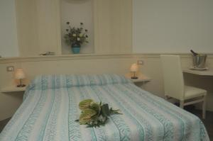 A bed or beds in a room at Albergo Antica Rosa