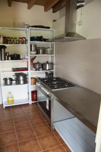 A kitchen or kitchenette at Albergue Dharma Gaia