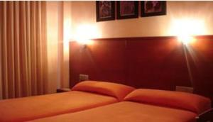 A bed or beds in a room at Hotel Sant Quirze De Besora