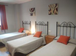 A bed or beds in a room at Hostal la Molina