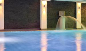 The swimming pool at or near Familotel DAS LUDWIG