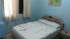 Cama ou camas em um quarto em Pousada My Power