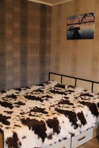 Кровать или кровати в номере Malaya Samara Apartment