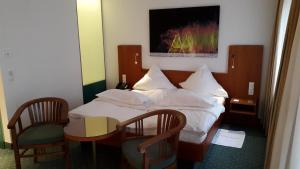 A bed or beds in a room at Hotel Unger
