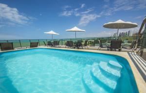 The swimming pool at or near Hotel Corais de Tambau