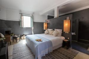 A bed or beds in a room at Riad Olema et Spa