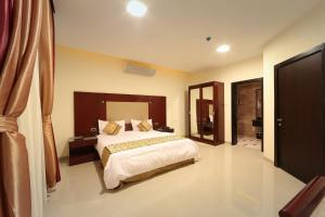 سرير أو أسرّة في غرفة في رؤوم ان سكاكا