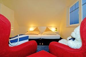 Ein Bett oder Betten in einem Zimmer der Unterkunft Appartementhaus Ostseeresidenz