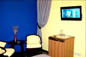 Телевизор и/или развлекательный центр в Отель Ковчег