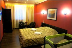 Кровать или кровати в номере Отель Ковчег
