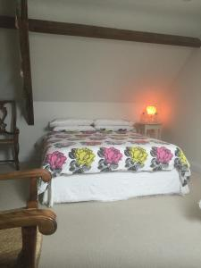 A bed or beds in a room at Greenhill Farm Barn B&B